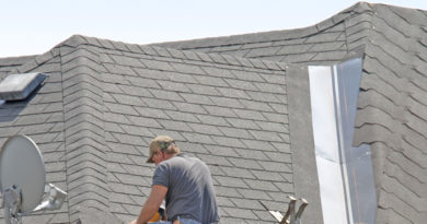 Roof Contractor in Grand Rapids Michigan Installing 3 Tab Shingles